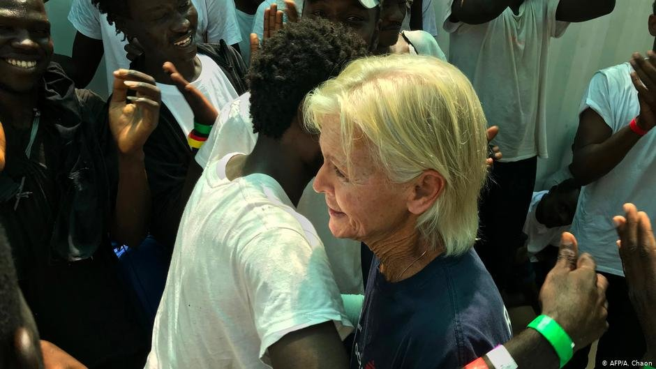 MSF-nurse Mary jo Frawley embraces Sudanese refugee Omar on board the Ocean Viking - 15 years after their first encounter |PHOTO: AFP/A. Chaon