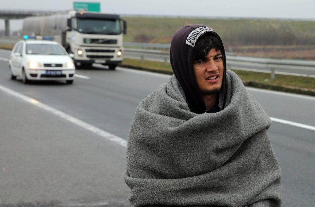 A migrant walks with police assistance on the highway Belgrade-Zagreb near Pecinci, 50 km from Belgrade. Credit: EPA/ Koca Sulejmanovic