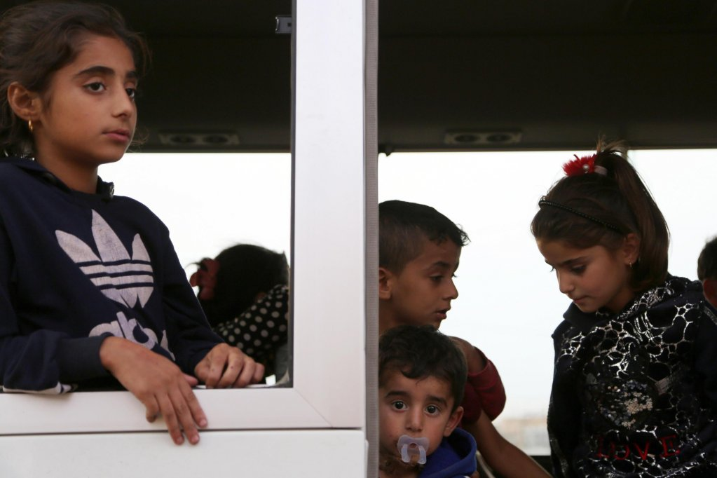 Syrian children who fled with families the conflict areas arrive at Bardarash refugee camp, in South of Duhok, Kurdistan region, Iraq, 21 October 2019 | Photo: EPA/GAILAN HAJI