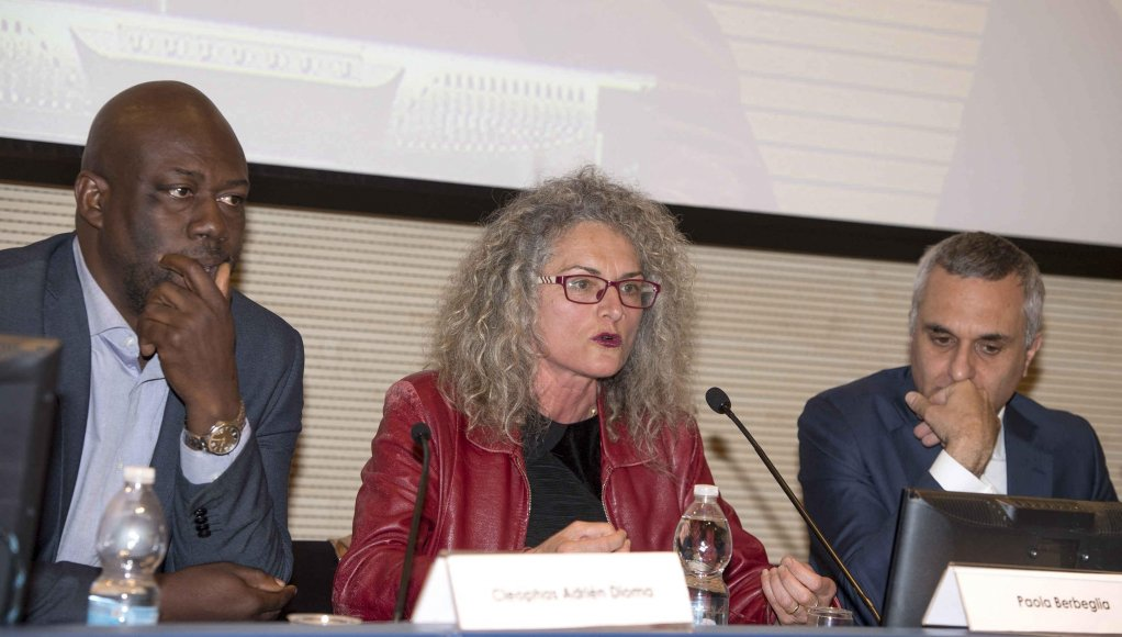 The conference at the Italian Foreign Ministry with Cleophas Adrien Dioma and Paola Berbeglia   Credit: ANSA