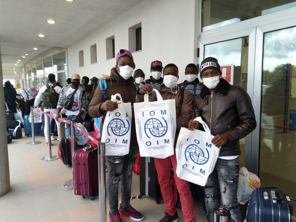 A picture of the asylum seekers on their way to Germany, waiting to board the plane in Crotone airport in Italy | Source: IOM Press release