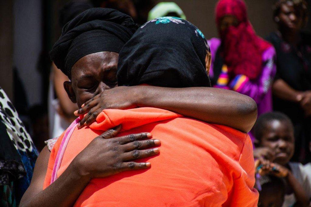 Two migrants hugging | Credit: Hmouzi/IOM Libya