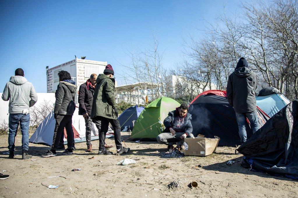 Migrants at a camp in Calais, France | Photo: EPA/Sebastien Courdji