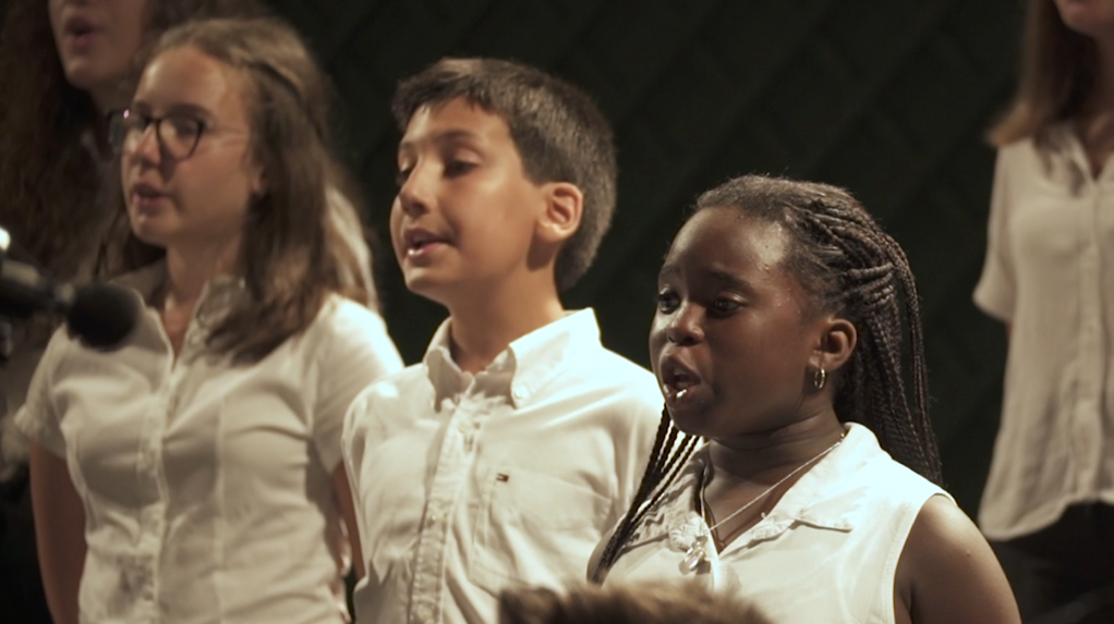 Eleven-year-old Carmela (right) sings in the Rainbow Choir, which unites children from Palermo's many migrant communities   Photo: Joseph Ataman