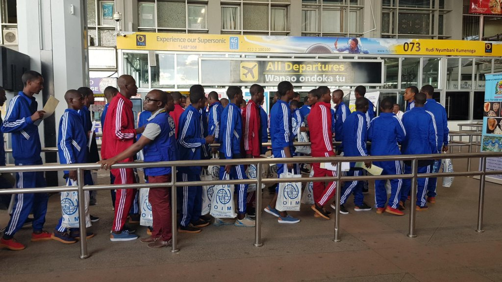 Ethiopian migrants prepare to board a flight back home from Tanzania. Credit: IOM