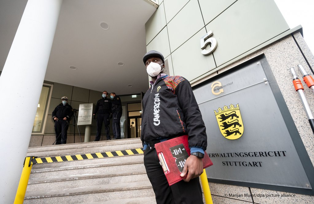 A refugee from Cameroon stands in front of the administrative court Stuttgart in the German state of Baden-Wuerttemberg   Photo: Marijan Mura/picture-alliance/dpa