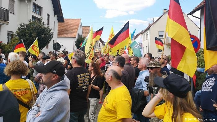 Protestors listen to a speech during the right-wing Frauenbündnis Kandel demonstration in Kandel,  Germany