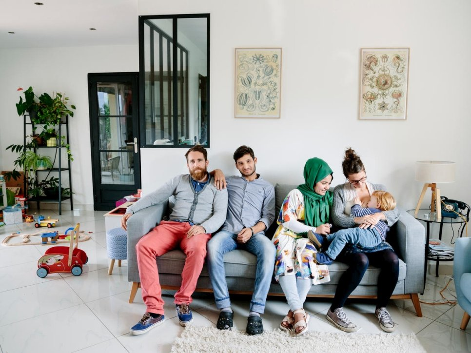 Anaïs, Vincent, and their son César, host Afghan refugees Zulfeqar and Battarine in Saint-Priest. The Afghan couple are like second parents to the French toddler.  © UNHCR/Aubrey Wade
