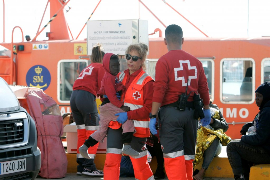 Spanish Red Cross members in Melilla on January 3 assisting some migrants upon their arrival, after they were rescued from a small boat. (Photo: EPA/F.G. Guerrero)