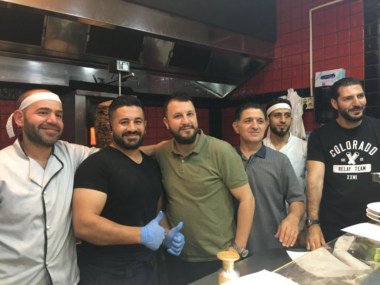Maurice Salloum (third from left) with some of his staff | Photo: Leslie Carretero