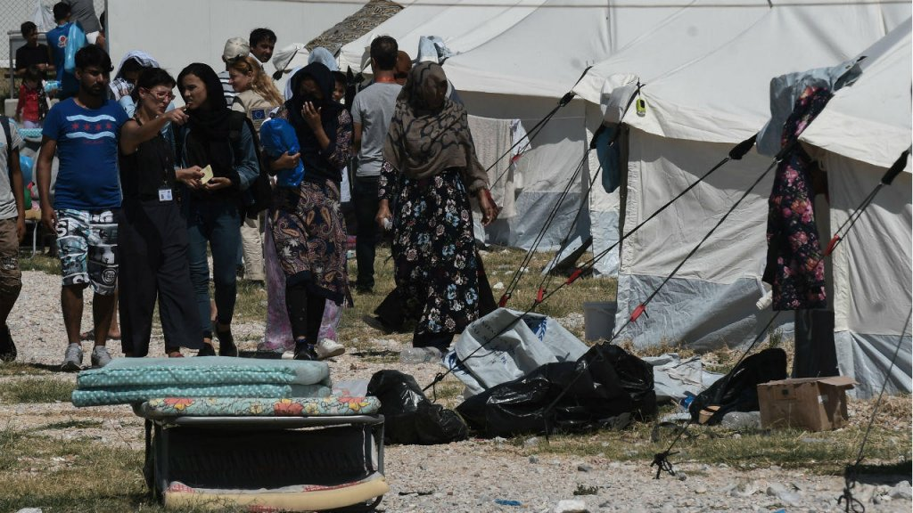 Migrants being transferred to the Nea Kavala camp near Kilkis in northern Greece  Photo Sakis MitrolidisAFP