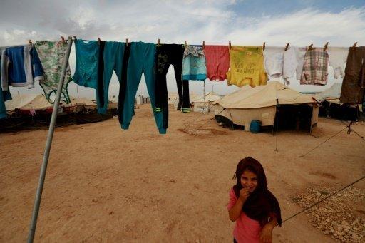 أ ف ب/ أرشيف | فتاة من دير الزور في شرق سوريا في مخيم في محافظة الحسكة المجاورة في 08 تشرين الأول/أكتوبر 2018