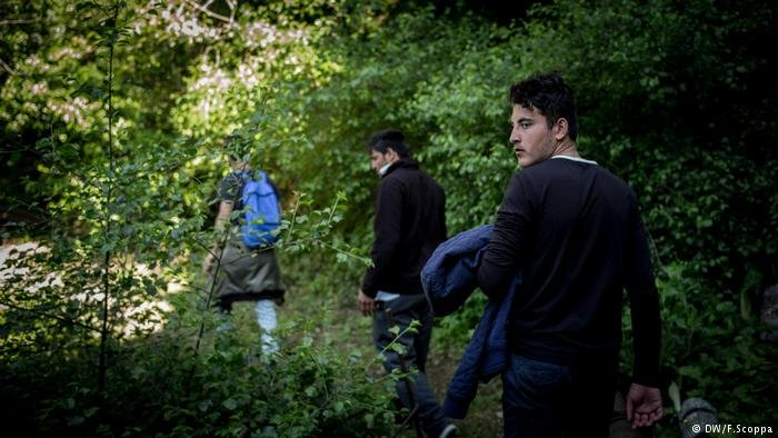 A small group of Afghan teenagers, fearful of being followed by police, set off on the roughly 12-kilometer (seven mile) hike along roads and the dangerous mountain tracks of the Death Pass to France / DW
