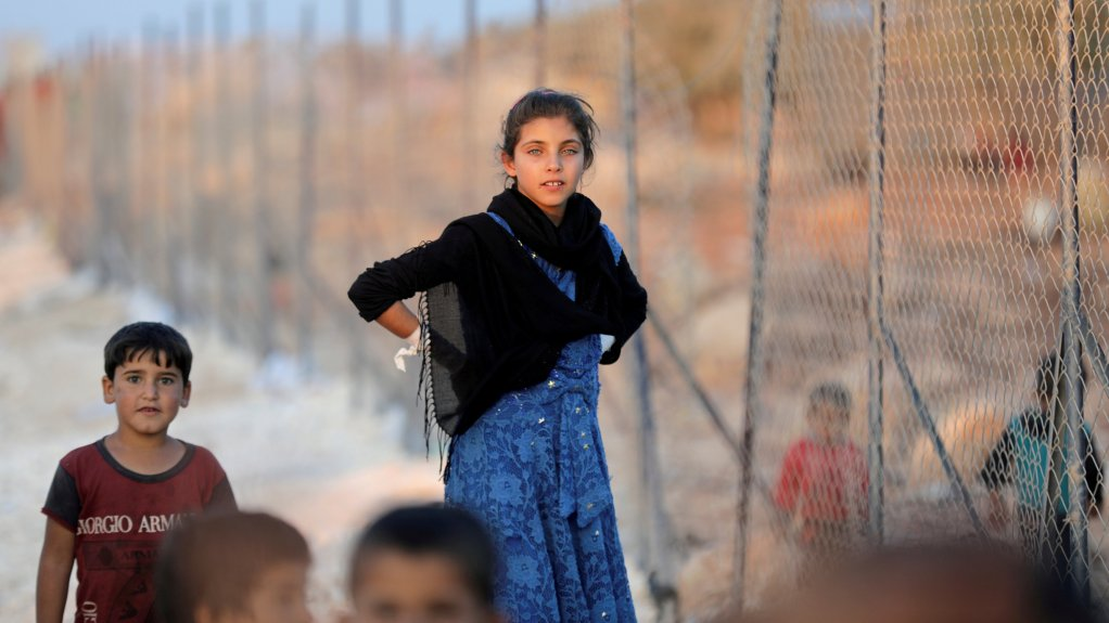 Une jeune Syrienne photographiée dans un camp de réfugiés de la province d'Idlib le 11 septembre 2018. Crédit : REUTERS/ Khalil Ashawi