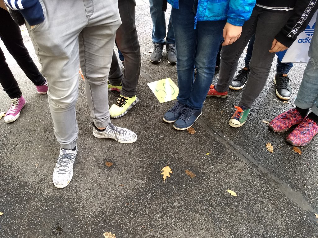 The feet of Czech schoolchildren listening to Saeds tour  Photo Emma Wallis