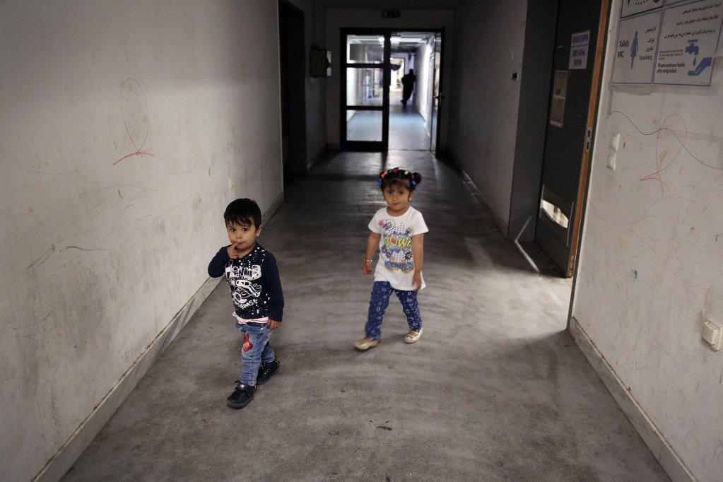 Children living in an abandoned Olympic complex in Athens   Credit: EPA/SIMELA PANTZARTZI