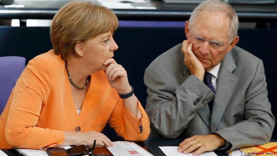 German Chancellor Angela Merkel speaks with then-Finance Minister Wolfgang Schäuble (Reuters/F.Bensch)