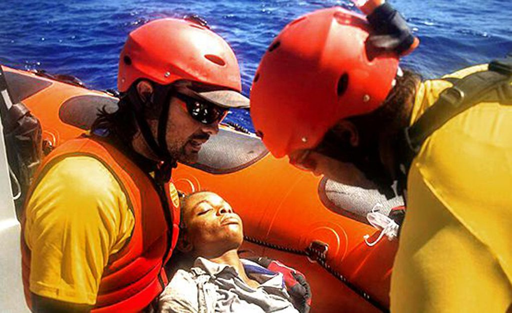 Proactiva Open Arms ngo operatives assist a migrant  Credit: Open Arms