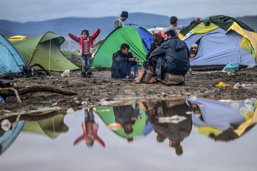 Refugees sit between tents at the border between Greece and the Former Yugoslav Republic of Macedonia (FYROM), near Idomeni, northern Greece | Credit: ANSA archive