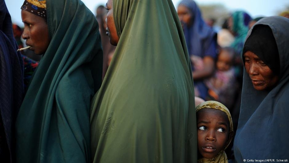 Women and a girl huddle in a queue at the Dadaab refugee camp in Kenya  Photo Getty ImagesAFPRSchmidt