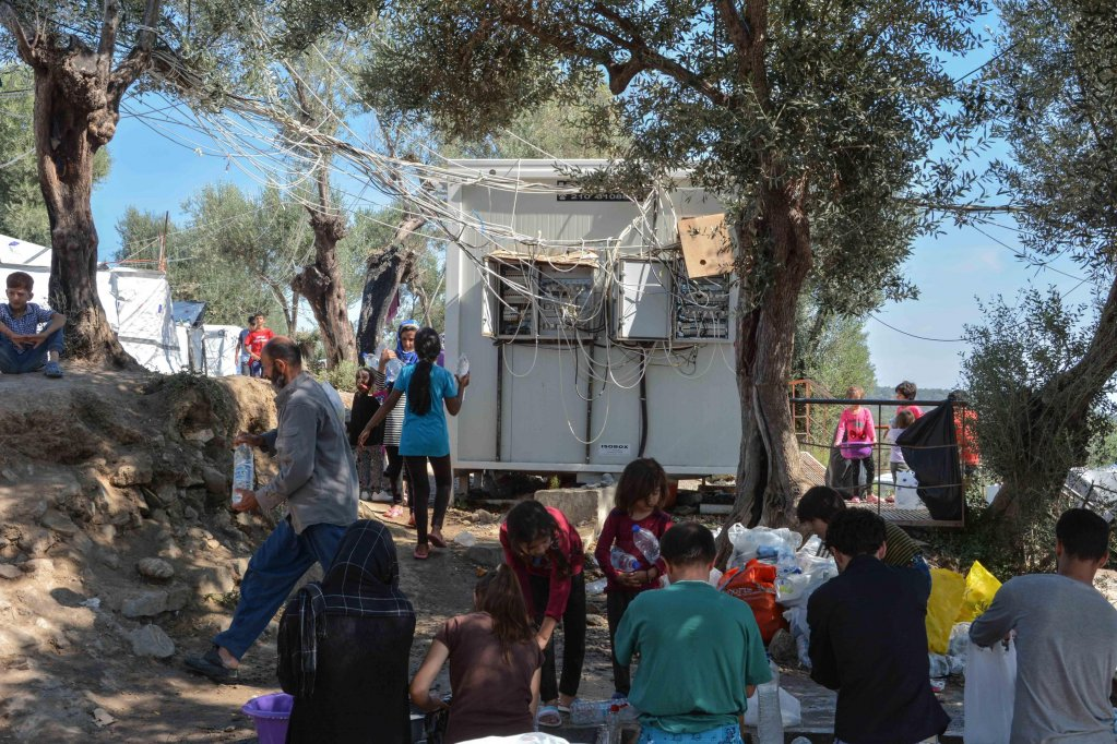 People in a makeshift camp outside the refugee camp of Moria Lesbos island Greece Photo EPAPANAGIOTIS BALASKAS