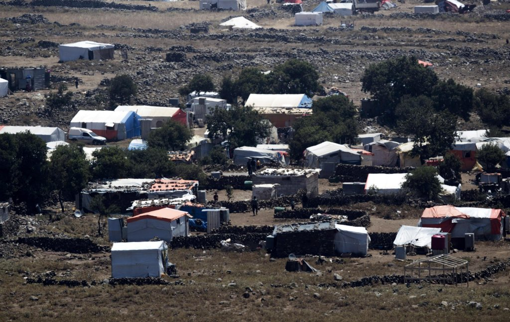 Syrian refugee camp near the village of al-Rafeed, next to the Israeli-Syrian border in the southern province of Daraa, as seen from the Israeli side of the border in the Golan Height, Israel Credit: EPA/Atef Safadi