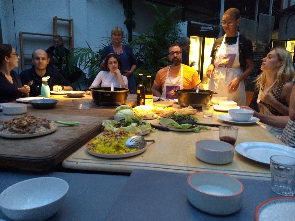 Sitting around to eat at the Migrateful Lebanese cooking class | Photo: Emma Wallis