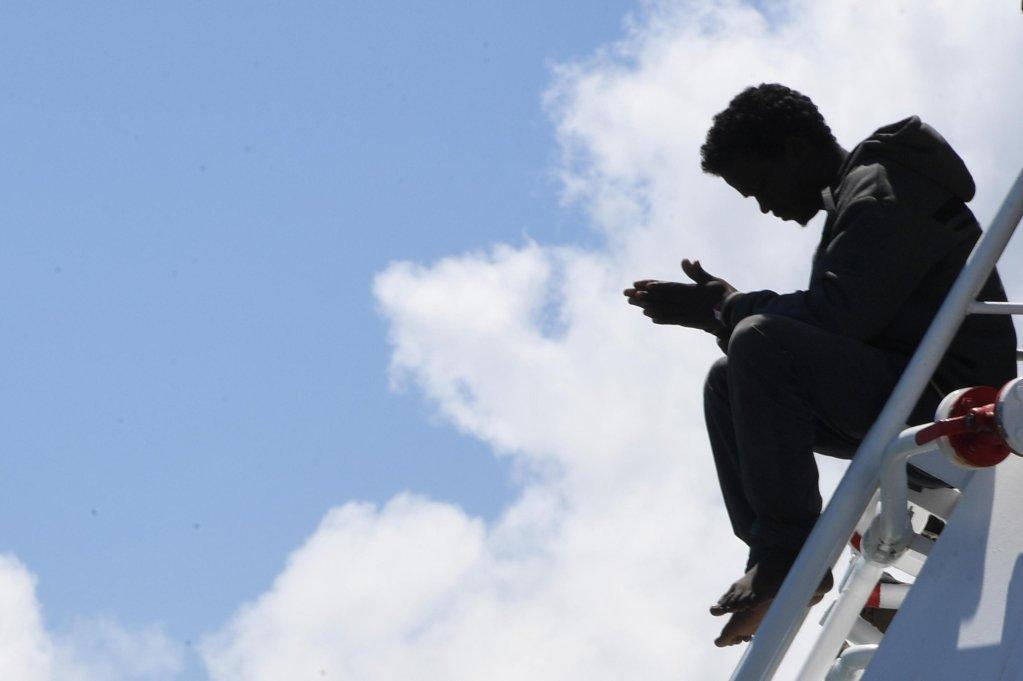 A migrant waits to disembark from the Spanish ship Rio Segura in the harbor of Salerno Italy June 29 2017  Photo ANSACiro Fusco
