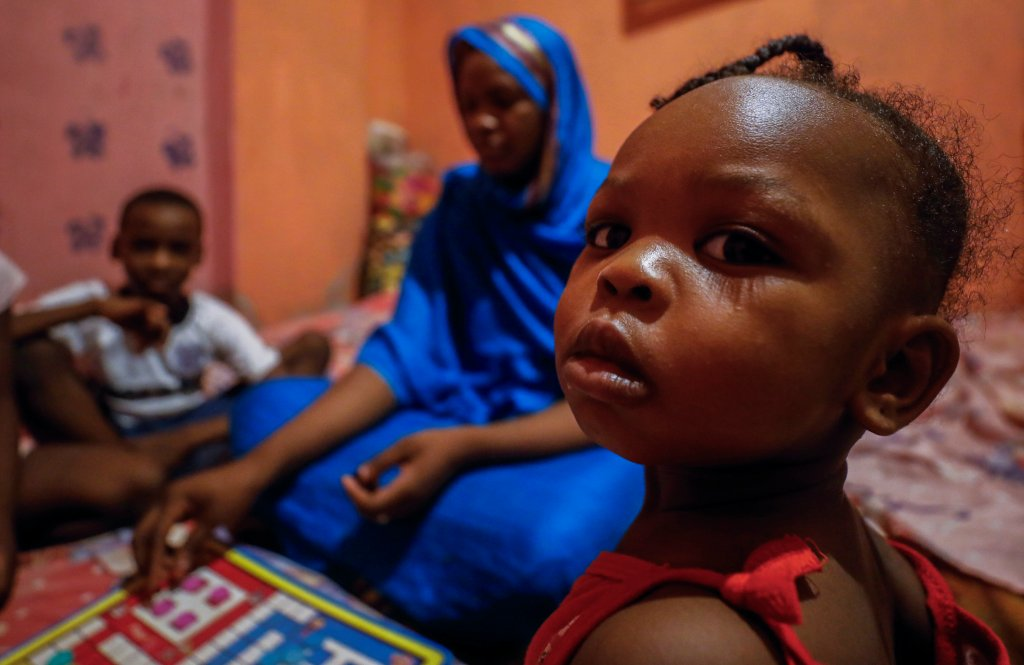 With six children and her sick father and two other relatives concerns about money are uppermost in this Sudanese refugee familys mind  Photo Reuters