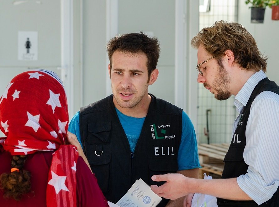 ELIL lawyers talk with a client in Lesbos  Photo ELIL