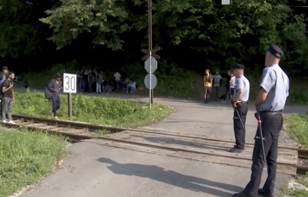 Video grab Migrants are directed off a railroad by police blocking the path in Bosanska Otoka Bosnia Monday August  24 2020  Photo Picture-allianceAP Photo
