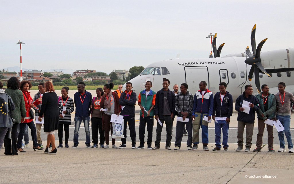 Part of the first group of Eritrean asylum seekers wait to board a plane of Italys Finance police heading for Sweden at Romes Ciampino Airport on October 9 2015  Photo picture alliancedpa