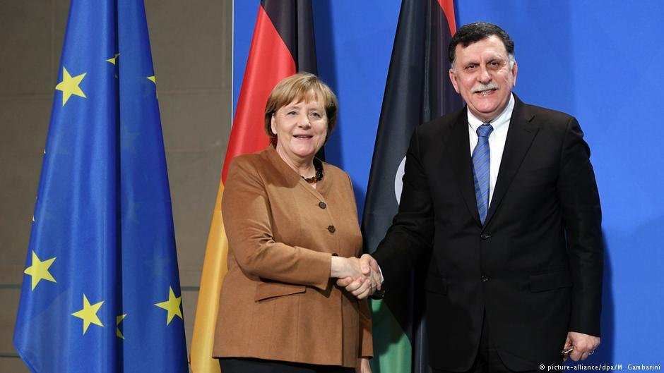 Germanys Angela Merkel and Libyas Fayez al-Sarraj in December 2017
