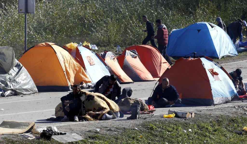 A group of migrants attempting to cross into Croatia gather around tents erected near the Maljevac border crossing, Bosnia and Herzegovina, 25 October 2018. EPA/FEHIM DEMIR