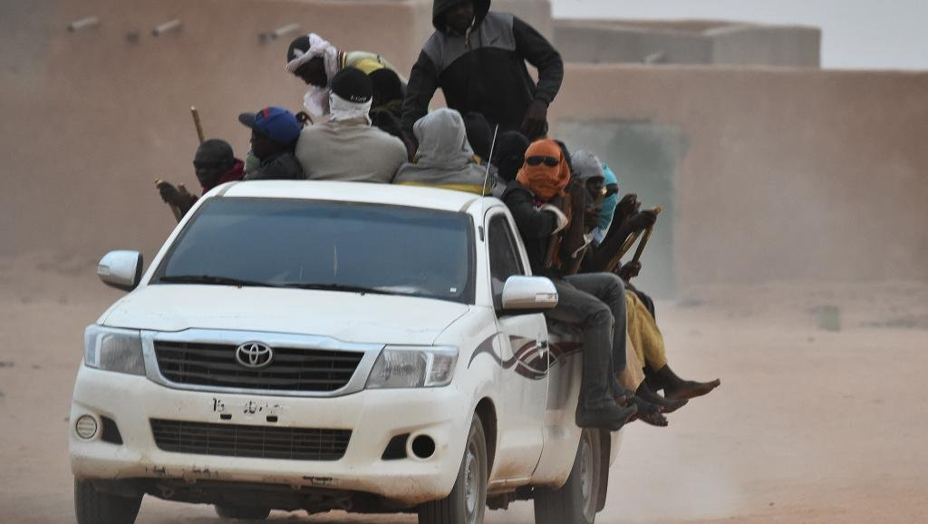 A truck transports migrants in Niger Credit: AFP/Issouf Sanogoissouf Sanogo