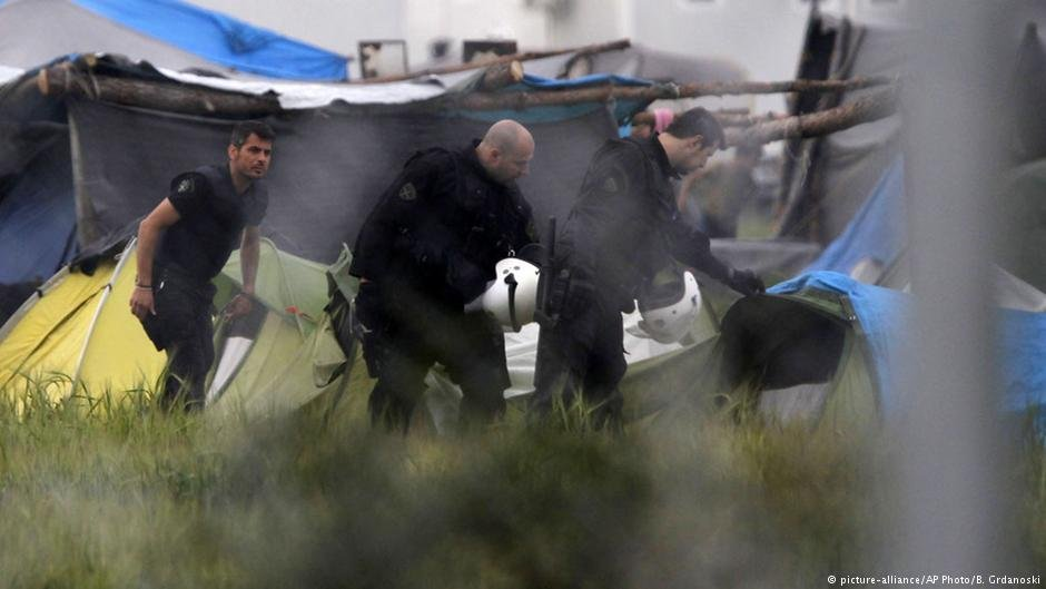 From archive: Greek police inspect tents at a makeshift refugee camps at Greek-Macedonian border near Idomeni