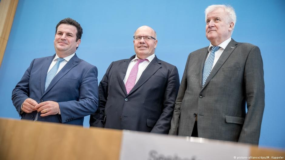 Hubertus Heil, Peter Altmaier, and Horst Seehofer (left to right) beamed with pride at their new law | Photo:  picture-alliance/dpa/M. Kappeler