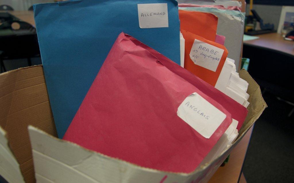 پروندههای دانشآموزان. عکس از: مهاجر نیوز