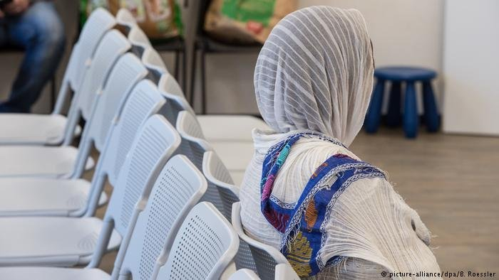 Woman in waiting room in Germany  Photo Picture-alliancedpaBRoessler