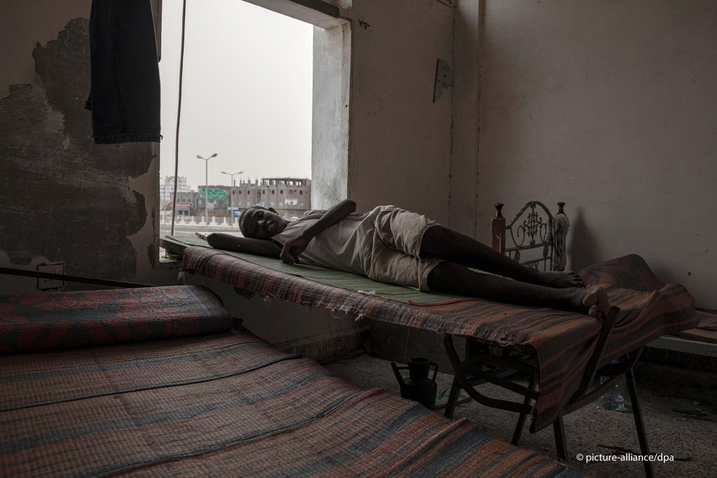 A 14-year old Ethiopian migrant who was physically abused on his journey crossing into Yemen rests on his makeshift bed in the 22nd May Soccer Stadium   Photo picture-allianceAP PhotoNariman El-Mofty