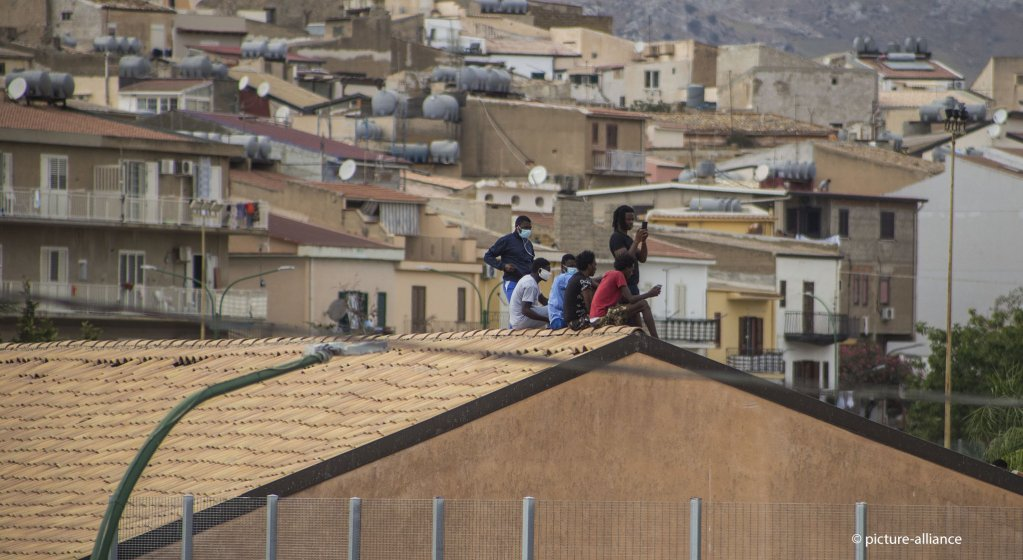 MIgrants climbed on the roof of the Villa Sikania center during a protest in September 4 2020  Photo picture-alliance