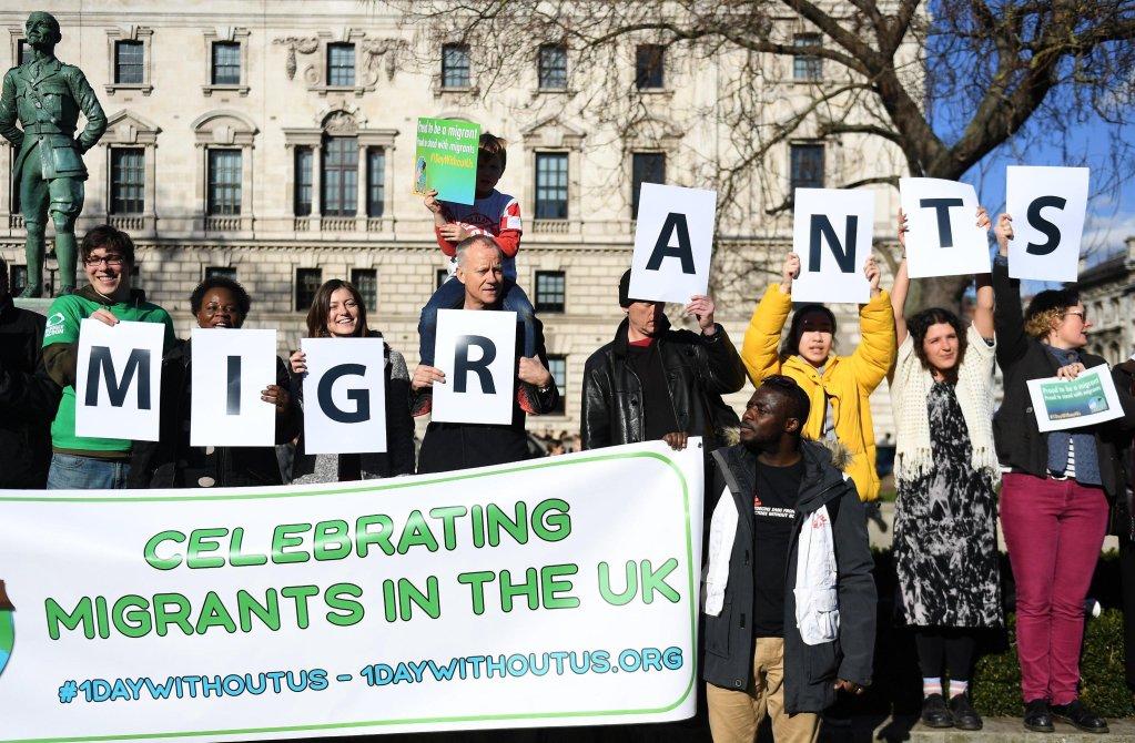 Migrants protest on Parliament Square, London | Credit: EPA/ Andy Rain