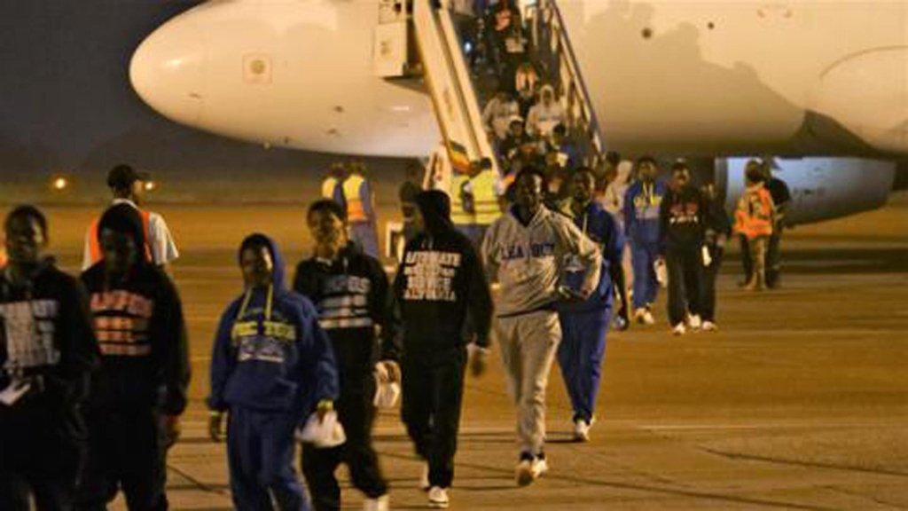 Returnees landing in Conakry, Guinea. Credit: Lucas Chanedlier/UN Migration Agency IOM)