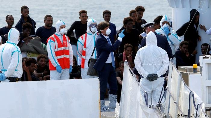 Unaccomanied minors gather on board the Diciotti before disembarkation