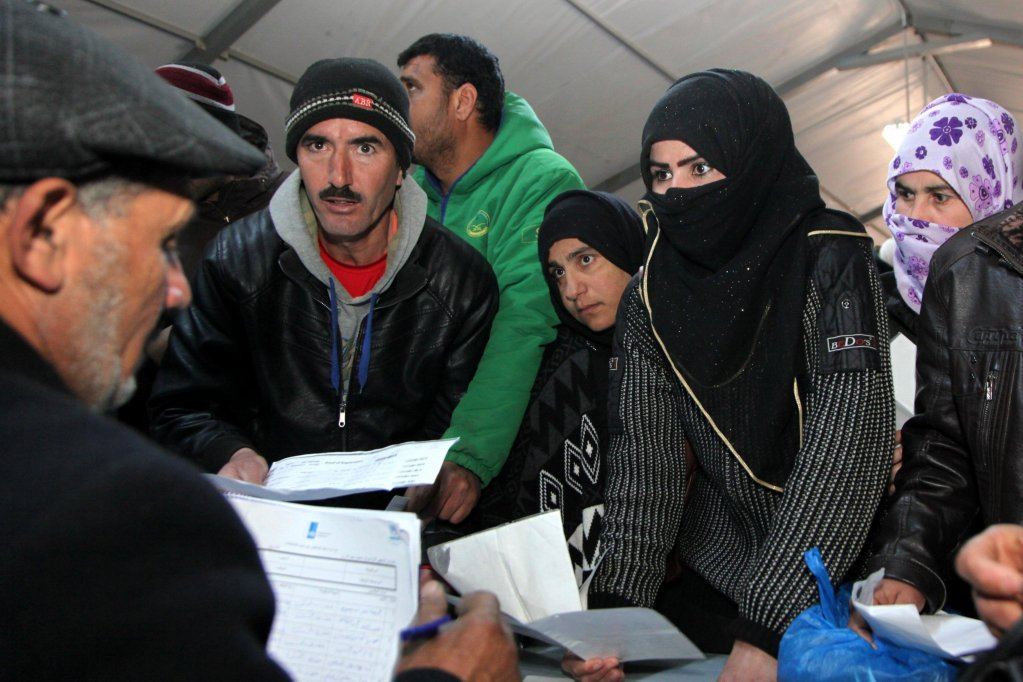 Syrian refugees register their names at the Azraq office for employment in Azraq, Jordan Credit: EPA/ Ahmad Abdo