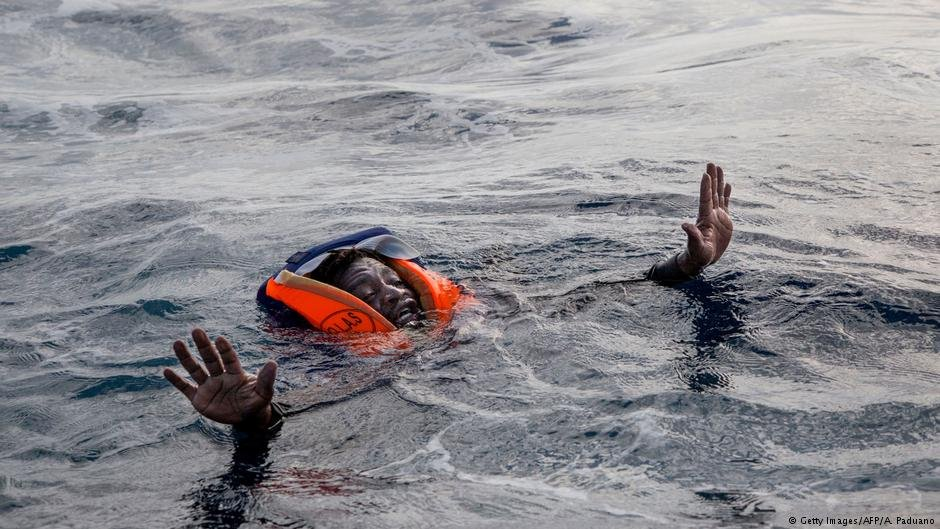A migrant in the sea after a shipwreck