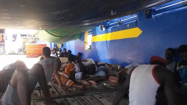 "Migrants onboard the ""Sarost 5"", a Tunisian supply vessel"