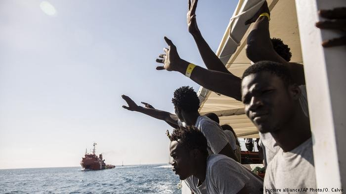 Migrants rescued near Libya aboard the Open Arms aid ship react as the ship approaches the port of Barcelona in Spain (Archive)