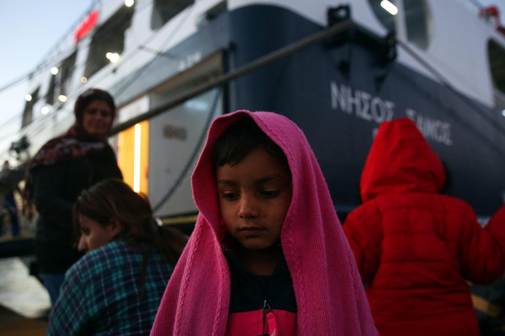 Refugees wait for Transport after they arrived on the Ferry 'Nissos Samos' from the Lesvos Island at the port of Piraeus, Greece, 11 December 2017/EPA