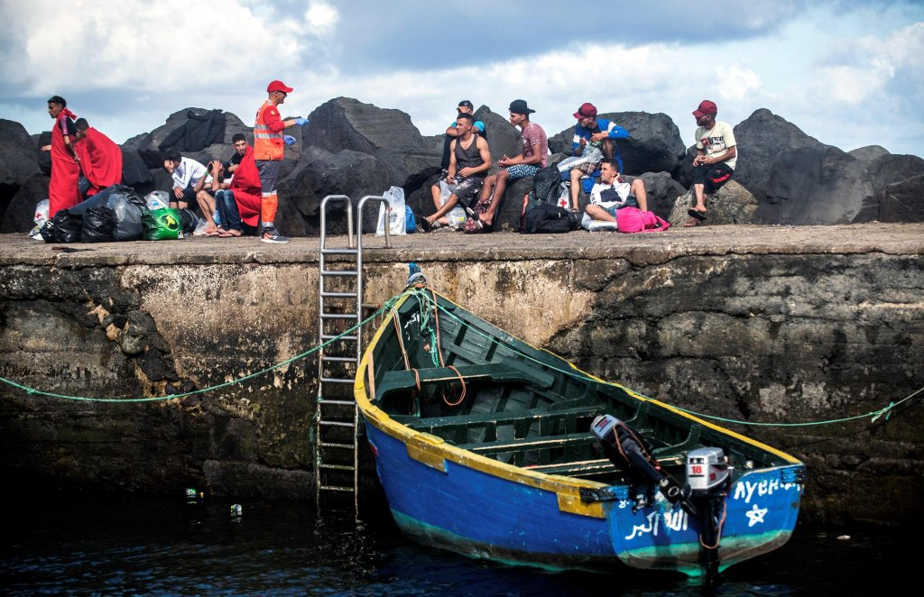 Maghrebi migrants resting in La Santa port after being rescued by a fishing boat at the town of Tinajo, Lanzarote island, southwestern Spain, 10 October 2018. PHOTO/EPA/JAVIER FUENTES